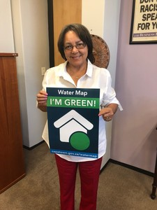 "City of Cape Town executive mayor Patricia de Lille holding a poster ""Water Map – I'm Green!"""